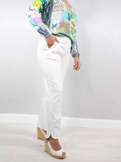 Model wearing the Vilagallo Ornella KN Trouser in the White colour featuring rounded hem to the bottom of each leg