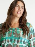 Closeup of the Samoon Flared Blouse in the Blue colour featuring a rounded neckline, buttons