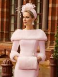 Close up image of model wearing Veni Infantino for Ronald Joyce Bateau Neckline Dress with Faux Fur in Blush, Style 991810