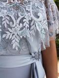 Close up of Veni Infantino for Ronald Joyce Strapless Dress with Cape in Silver