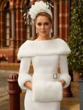 Close up of model wearing Veni Infantino for Ronald Joyce Bateau Neckline Dress with Faux Fur in Ivory, Style 991810
